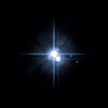 This file image provided by NASA on Feb. 22, 2006 from it's Hubble Space Telescope shows Pluto and three of it's five moons.
