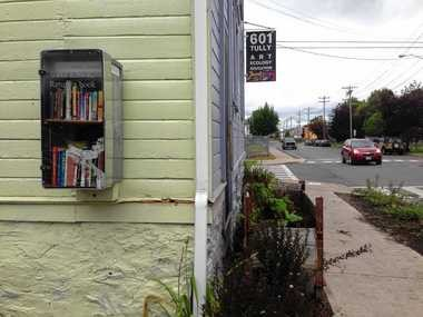 This Little Free Library at 601 Tully St. had some minor damage to its door in early September. Overall, there have been few problems with the three little libraries since they started in 2012.