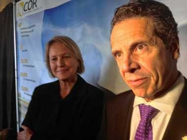 Onondaga County Executive Joanie Mahoney stands next to Gov. Andrew Cuomo during an announcement at Syracuse's Inner Harbor in Syracuse, N.Y.