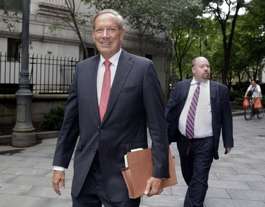 Former New York Gov. George Pataki, left, arrives for a Federal Court appearance, in New York, in 2013. Pataki testified about how more than 100 sex offenders came to be involuntarily institutionalized when they finished prison sentences. His testimony came in a civil trial in Manhattan federal court after six convicted sex offenders sued Pataki and the state.