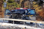 A New York State Police vehicle rests near the guardrail on Route 23 in Catskill, N.Y. after being involved in a collision with a pickup truck on Wednesday, Jan. 14, 2015.