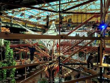 Patrons climb the 70-foot-tall ropes course at WonderWorks in Destiny USA in Syracuse. About 25 percent of the shoppers who come to the 2.4-million-square-foot mall are Canadian.