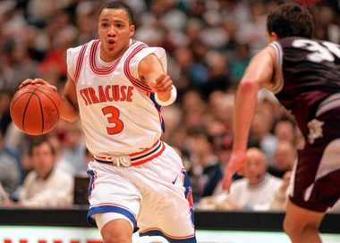 SU point guard Lazarus Sims drives the lane and directs traffic during a 1995 game against Lafayette College. Sims has been named the new city parks commissioner in Syracuse.