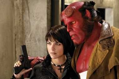 The world's toughest, kitten-loving superhero, Hellboy (RON PERLMAN), and his girlfriend, pyrokinetic Liz (SELMA BLAIR), search for answers in Hellboy II: The Golden Army in this file photo.