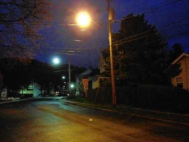The yellow glow of the sodium-vapor streetlight in the foreground contrasts with the bluish white of newer LED lights in the background on Chemung Street, at the border between Syracuse and Solvay. The village of Solvay, which owns its streetlights, has cut their energy consumption by nearly 80 percent by installing LEDs. National Grid, which owns most of the streetlights in Syracuse, says LED streetlights are too expensive to justify their use.