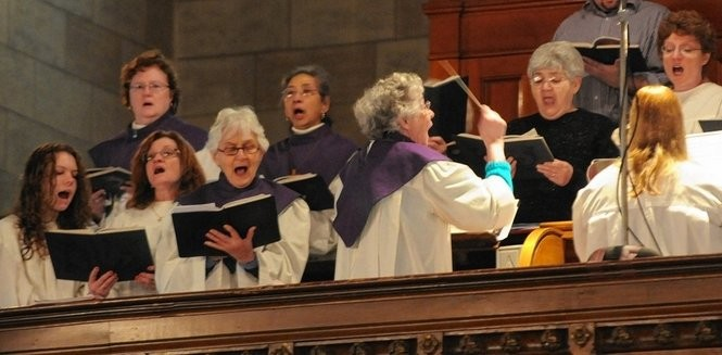 Anne Angiolillo directs the church choir at the last mass at Holy Trinity Church in 2010. Stephen D. Cannerelli / The Post-Standard