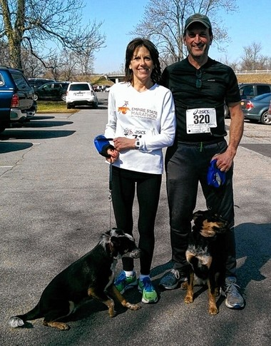 Tom Frechette, of Onondaga, posed for this picture in the spring of 2015 with his fiancee, Galyn Schenk, and their dogs after running in a 5k charity race.