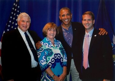 Retired DeWitt Town Justice Jack Schultz and his wife Sybil, pose for a photo with President Barack Obama, and their son, Eric, who is Obama's deputy press secretary, at Henninger High School in Syracuse, N.Y., during Obama's visit on Aug. 22, 2013.