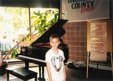 Eric Schultz, at age 5, during a piano recital. The former DeWitt resident is deputy press secretary for President Barack Obama.