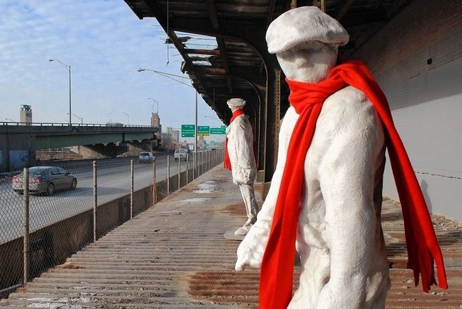 """In this file photo from 2009, the statues of """"Waiting for the Night Train"""" on the old New York Central train platform wear red scarves.The platform, which was on the railroad mainline, was used until 1962. The state plans to spend $1.5 million to repair and restore the station in the heart of Syracuse on I-690."""