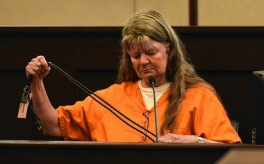 Deborah Leonard holds the cord that she and others used to beat her sons during a counseling session at the Word of Life Church. Oneida County District Attorney Scott McNamara asked her to show him how she held it at the time. Leonard testified Thursday, June 30, 2016, during trial in Oneida County Court in Utica. L