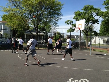 Cops and neighborhood kids shoot hoops during a 3-on-3 tournament at Skiddy Park on May 21, 2013.