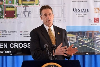 New York State Lt. Gov. Robert Duffy announces the planned redevelopment of Kennedy Square at a December 2011 news conference.