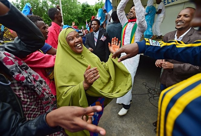 Sofia Roble dances with other people from Somalia in front of stage during World Refugee Day at Schiller Park in 2014.