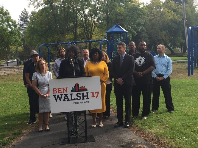 Councilor-At-Large Helen Hudson endorses mayoral candidate Ben Walsh at a press conference at Loguen Park on Tuesday, Oct. 10, 2017. She is joined by city school board member Katie Sojewicz (left) and Onondaga County Legislator Monica Williams (center, yellow dress).