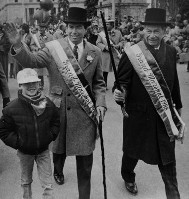 In the 1988 St. Patrick's Day Parade on S. Salina St. Grand Marshals Jim Walsh (left) and his father William Walsh wave alongside a young Ben Walsh.