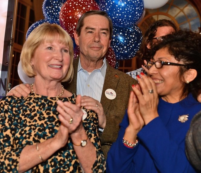 Ben Walsh's parents, Jim and Dede, look on as he accepts victory at the Marriott Syracuse Downtown' s Grand Ballroom, Tuesday, Nov. 7, 2017.