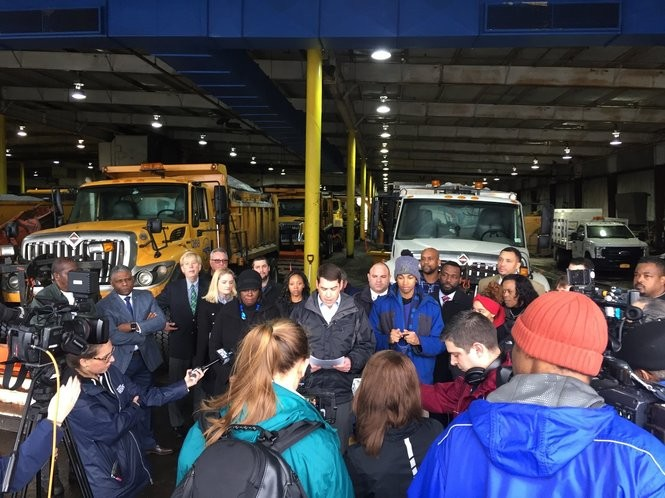 Mayor Ben Walsh announces a snow safety plan at the Department of Public Works garage on Canal Street. Behind him are members of his administration and several Common Councilors.
