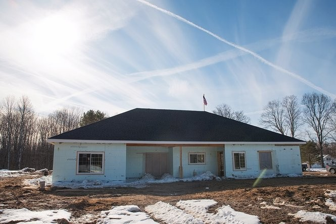 National nonprofit Homes for Our Troops is building an accessible home for Oswego County veteran Ryan Wilcox. An American flag flies from the roof; after construction is complete, the flag will be presented to Wilcox and his family.