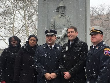 Chief Michael Monds, center, poses for a photo withcity leadership, Saturday, Dec. 16, 2017, at the Firefighters' Memorial Park in Syracuse.