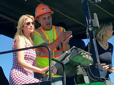 Ivanka Trump drives a paver at the Suit-Kote headquarters on Monday.