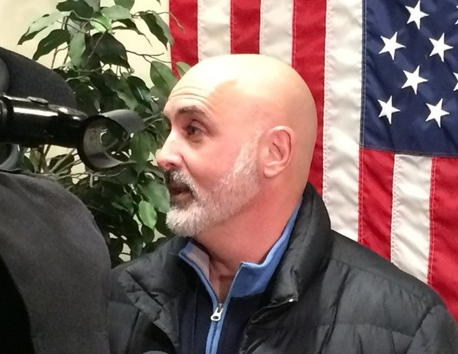 John Tumino, of In My Father's Kitchen, talks with reporters at the Onondaga County executive offices about a day labor program for panhandlers.