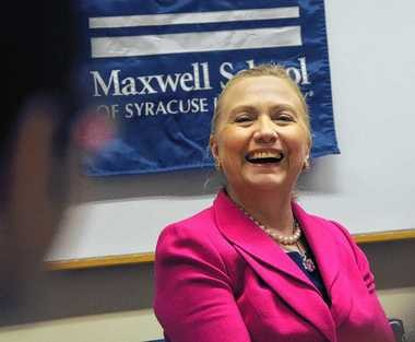 Secretary of State Hillary Rodham Clinton laughs at one of the student's introduction during a Maxwell School of Citizenship and Public Affairs honors class held April 23 at Eggers Hall on the Syracuse University campus. Clinton came to Syracuse to honor a commitment James Steinberg, her former deputy and now dean of the Maxwell School.