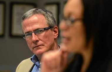 Stephen Swift, president of the Syracuse school board, listens to Superintendent Sharon Contreras during an editorial board meeting at The Post-Standard earlier this month.