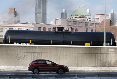 A railroad oil tanker car is parked along Interstate 787 in downtown Albany on Friday, Feb. 7. The Port of Albany has become a hub for the U.S. oil business, taking shipments from North Dakota's Bakken Shale daily by mile-long trains and shipping it in tankers down the Hudson River to refineries.
