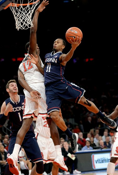 St. John's center Chris Obekpa attempts to block Connecticut guard Ryan Boatright's on Wednesday at Madison Square Garden.
