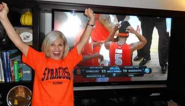 Kathleen Cohen celebrates in her Atlanta home after watching the Syracuse men's basketball team advanced to the Final Four.