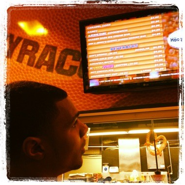 Michael Gbinije surveys his options at a Carrier Dome concession stand.
