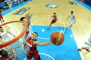 Syracuse's freshman point guard Tyler Ennis, representing his native Canada, goes to the rim in a game vs. China.