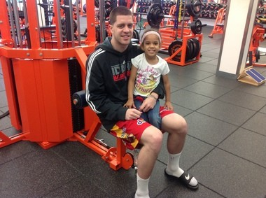 Eric Devendorf and his daughter Madelyn pose for a photo earlier this summer in the Melo Center weight room.