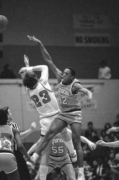 Syracuse center Rafael Addison competes with St. JohnAC/AAs center Bill Wennington (23) for a jump ball during a game on Feb. 27, 1984, in New York. Syracuse defeated St. JohnAC/AAs 82-81 in overtime.