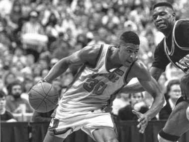Syracuse forward Billy Owens drives past Georgetown center Dikembe Mutombo in a game on March 3, 1991, at the Carrier Dome.