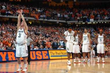 Syracuse guard Gerry McNamra shoots three free throws at the end of the game after getting fouled during a game against Notre Dame on Feb. 5, 2005, at the Carrier Dome.