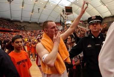 Gerry McNamara blows a kiss to the student section in the Carrier Dome in his final regular-season game against Villanova on March 5, 2006, at the Carrier Dome.