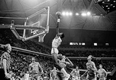 Virginiaas Ralph Sampson reaches for a rebound during Virginia's 74-60 victory over Brigham Young to win the NCAA East Regional Championship on March 23, 1981, in Atlanta.