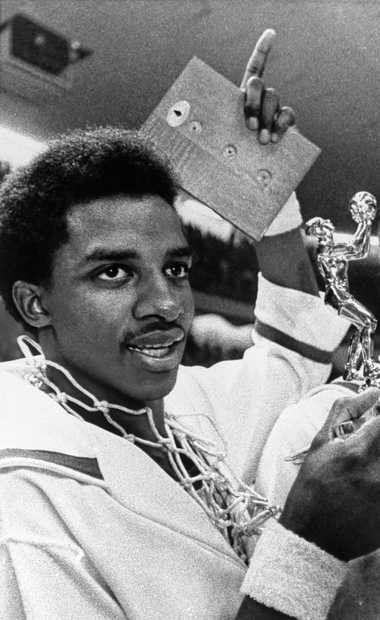 North Carolina State star David Thompson holds up a trophy after the 1974 Atlantic Coast Conference tournament.