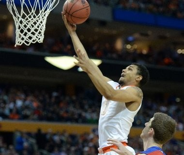 Syracuse's Michael Gbinije goes to the basket in first half action during a third round NCAA tournament game vs. Dayton on Saturday March 22, 2014 at the First Niagara Center in Buffalo.