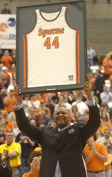 Syracuse great Derrick Coleman holds up his jersey in a halftime ceremony at the Carrier Dome on March 6, 2006. 2006