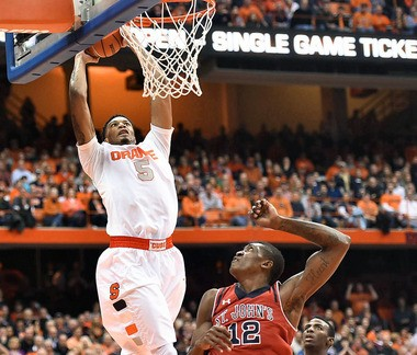 Syracuse's Chris McCullough dunks off an alley-oop pass in the second half of a game against St. John's on Dec. 6, 2014, at the Carrier Dome.
