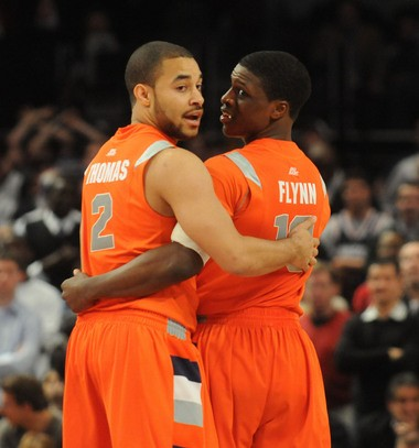 Justin Thomas and Jonny Flynn embrace near the end of Syracuse's six-overtime win over Connecticut in the 2009 Big East tournament quarterfinals.