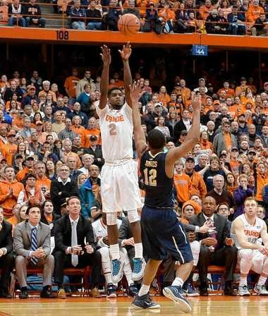 Syracuse forward B.J. Johnson (2) makes a 3-pointer from the corner in the second half of the Syracuse-Pittsburgh game at the Carrier Dome, Feb.21, 2015. Dennis Nett | dnett@syracuse.com
