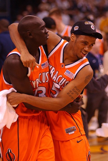 Josh Pace celebrates Syracuse's win over Kansas in the 2003 NCAA champion game with Kueth Duany.