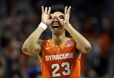 Syracuse's Malachi Richardson (23) celebrates after making a three pointer during the second half of an NCAA college basketball game against Virginia in the regional finals of the NCAA Tournament, Sunday, March 27, 2016, in Chicago. Syracuse won 68-62.