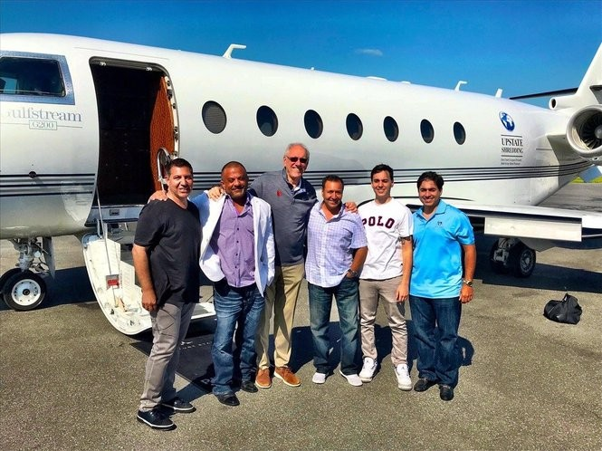 From left, Robert Santaro, Adam Weitsman, Syracuse University basketball coach Jim Boeheim, Attilio's restaurant owner Lou Santaro (brother of Robert) and Lou's sons, Nick and Anthony, before boarding Weitsman's jet in Syracuse for a trip to Cleveland Friday to watch Game 4 of the NBA Finals between the Cleveland Cavaliers and the Golden State Warriors.