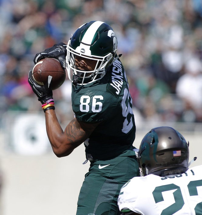Michigan State green team receiver Trishton Jackson (86) catches a pass against the white team's Josiah Scott during a spring NCAA college football scrimmage, Saturday, April 1, 2017, in East Lansing, Mich. The defense won 33-23. (AP Photo/Al Goldis)