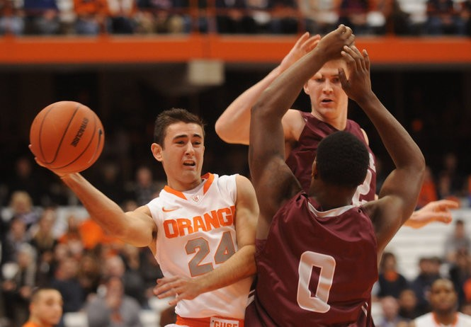 Syacuse's Brandon Reese drives baseline in the second half in the Orange's game against Colgate. Nov. 19, 2011 Dennis Nett/The Post-Standard